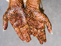 Henna hands. An indian bride holds out her henna hands Stock Photos