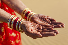 Henna Hands and Bangles. Stock Photos
