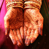 Henna Hands and Bangles Stock Images
