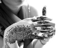 Henna hands. Beautiful closeup shot of girl hands with heena royalty free stock image