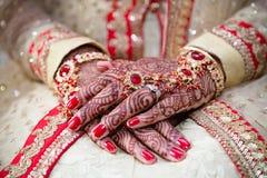 Henna hands crossed stock image
