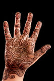 Henna (Mehndi) on a little girl's hand. Isolated on black Royalty Free Stock Photography