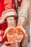 Henna paint on both hands for woman at Indian wedding ceremony in Bangkok, Thailand Royalty Free Stock Photography