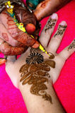 Henna painting applied to womans hand Royalty Free Stock Photos