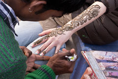 Henna painting on hand and arm Stock Photography