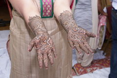 Henna painting on hands Stock Images
