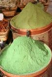 Henna powder. Green color henna powder at bazaar Stock Photos