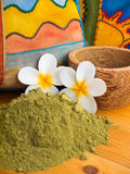Henna powder in the coconut bowl and two tiare flowers Royalty Free Stock Image