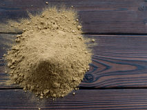 Henna powder pile on the dark wooden planks Royalty Free Stock Image