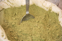 Henna powder. In sack in traditional market with a spoon ready for sell Stock Photos