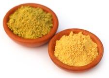 Henna and sandalwood powder. Over white background Stock Image