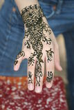 Henna Tattoo. Young woman shows off a new henna tattoo royalty free stock photo