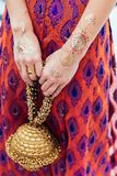 Henna tattoo on both hands and arms for woman at Indian wedding ceremony in Bangkok, Thailand Stock Image