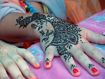 Henna tattoo. Female hand with Indian pattern made with henna Stock Photos