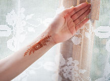 Henna tattoo on the girl's hand Royalty Free Stock Images