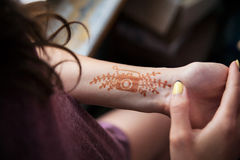 Henna tattoo on the girl's hand Stock Image