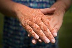 Henna tattoo on girl's hands Stock Photography