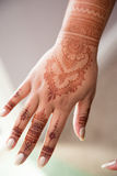 Henna tattoo on hand Stock Images
