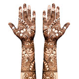Henna tattoo. Indian hand being decorated with henna tattoo royalty free stock image