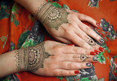 Henna tattoo mehendy drawing. Two hands with henna tattoos mehendi designs stock images