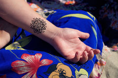 Henna tattoo mehendy on hand mandala Stock Image