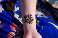 Henna tattoo mehendy on hand mandala. Black henna tattoo mehendy on hand mandala stock image