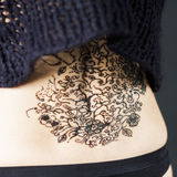 Henna tattoo on parts of a woman body Stock Image