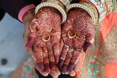 Henna tattoo on women hands also rings on hand Stock Photo