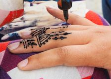 Henna tattoos being put on girls hand in Morocco. Henna tattoos being put on hands in Morocco stock photo