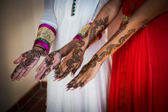 Henna Tattoos on hands. Image of Henna Tattoo's on an Indian bride's hands and friends stock image