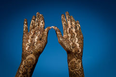 Henna Tattoos on hands. Image of Henna Tattoo's on an Indian bride's hands reaching to the sky stock image