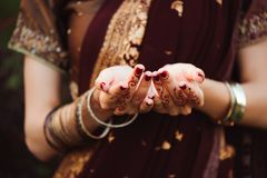 Henna wedding design, Woman Hands with black mehndi tattoo. Hands of Indian bride girl with black henna tattoos. Fashion.  stock photography