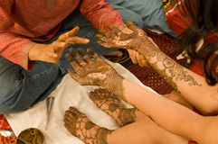 Hennas session. Final touch on henna session Royalty Free Stock Image