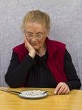 henne gammal kvinna för meds Royaltyfri Foto