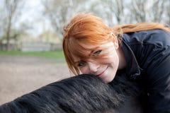 henne hästkvinnabarn Royaltyfria Bilder