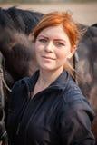 henne hästkvinnabarn Royaltyfri Bild