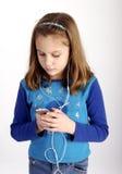 henne lyssnande musik till Royaltyfri Bild