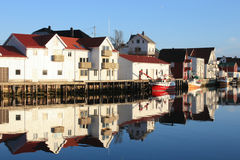 Hennigsvaer's dock's houses  mirroring Royalty Free Stock Image