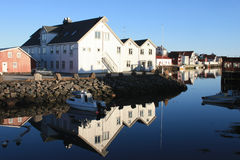 Hennigsvaer's dock's houses  mirroring II Royalty Free Stock Photos
