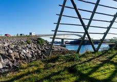 Henningsvaer bridge  and wooden rack for drying cod, Lofoten arc. Hipelago, Norway. National Tourist Route Lofoten Royalty Free Stock Images