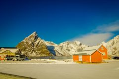 Henningsvaer, Norway - April 04, 2018: Outdoor view of wooden houses of a typical little village close to the shore at Royalty Free Stock Photo