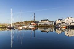 Beautiful reflection in the marina of Henningsvaer fishing village stock photo