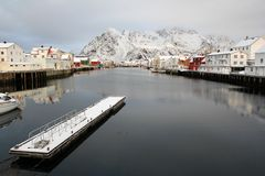 Henningsvaer pier and  mounts in wintertime Stock Photo