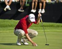 Henrik Stensons Final Putt. Henrik Stenson. Winner of the Nedbank Million Dollar Tournament 2008. Sun City Gary Player Golf Course. Meticulously placing his ball stock images
