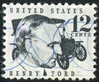 Henry Ford. UNITED STATES - CIRCA 1965: stamp printed by United States of America, shows Henry Ford and a car, circa 1965 royalty free stock photo