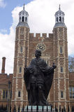 Henry VI Statue, Eton College, Berkshire. Statue of King Henry VI (1421 - 1471) in the School Yard with Lupton's tower behind, Eton College, Berkshire.  The King Royalty Free Stock Photo