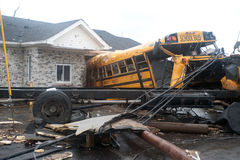 Henryville Tornado. HENRYVILLE, IN - USA, MARCH 8, 2012- A school bus is pulled from a building in Henryville, IN, nearly a week after an EF-4 tornado struck the Royalty Free Stock Photo