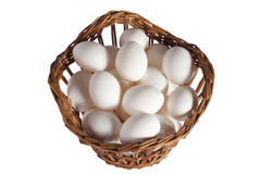 Hens eggs in a basket shot. In studio on white Stock Images
