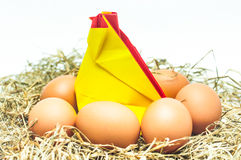 Hens incubate the eggs in the nest. Paper hen and real egg Royalty Free Stock Photography