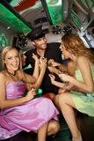 Hens night in limo. Usine with beautiful girls and handsome man Stock Photography